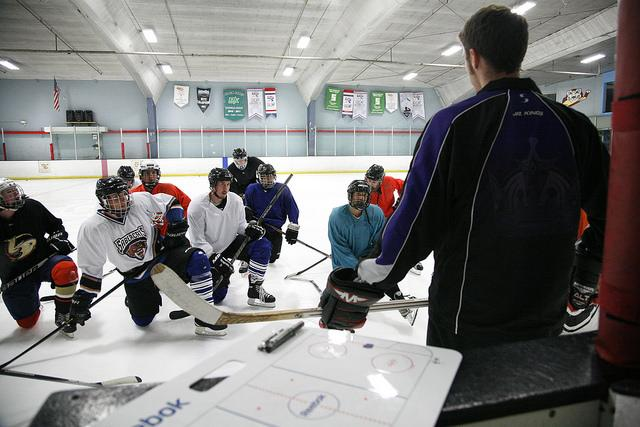 Coach Ryan Papazian addresses the SF State hockey team during a late night practice at Nazareth Ice Oasis in Redwood Center, Sunday Aug. 31. Martin Bustamante / Xpress.