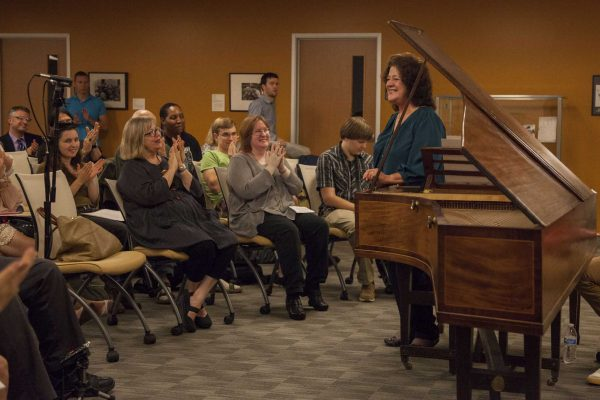 SF State music professor Victoria Neve stands to take a bow after playing a musical sonata from the de Bellis Collection on the Clementi fortepiano in the J. Paul Leonard Library Friday, Sept. 26, 2014. Frank Ladra / Xpress.