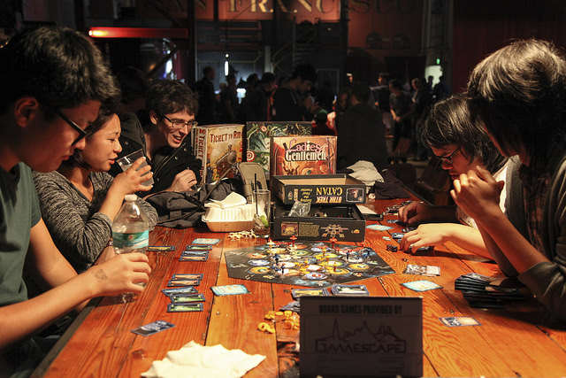 "Gaming fans engage in a strategic board game at the ""Churning the Butter"" event at the Folsom Street Foundry on Thursday, Sept. 11, 2014. Frank Ladra / Xpress."