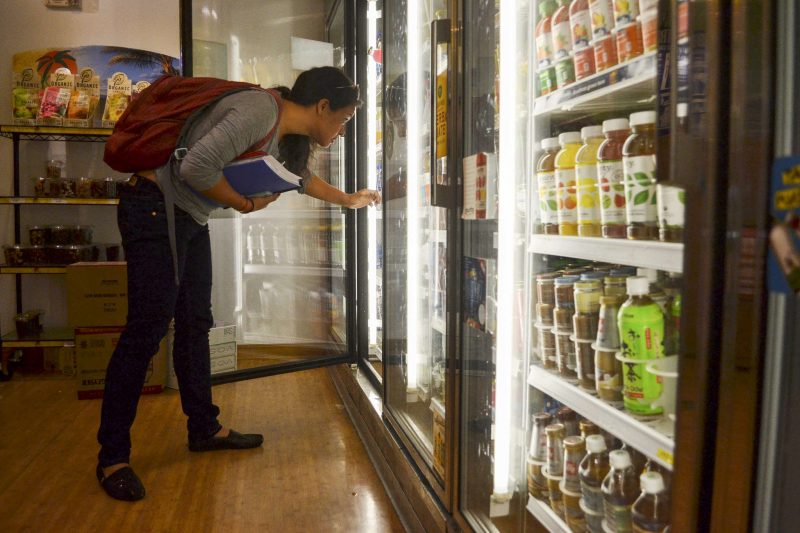 Thursday, Sept. 25, 2014, hospitality and tourism major Amanda Hoang decides on a drink between classes at Healthy U in the Cezar Chavez Student Center. Helen Tinna / Xpress.