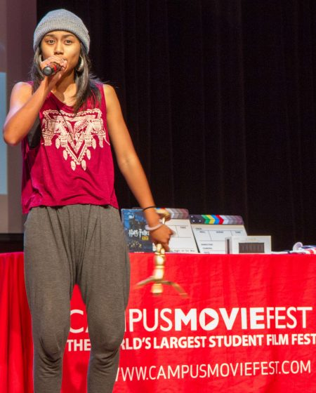 """Evelyn Obamos sings to celebrate her award for Best Actress for her role in the film """"The Line,"""" on Thursday, Oct. 9, 2014, in Jack Adams Hall in the Cesar Chavez Student Center at SF State. Eric Gorman / Xpress."""
