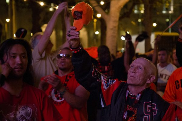 "Howard ""Crazy Legs"" Rowe holds up his hat in honor of the performance of ""God Bless America"" during Game 7 of the World Series in the Civic Center Plaza in San Francisco, Calif. Wednesday, Oct. 29, 2014. Eric Gorman/Xpress."