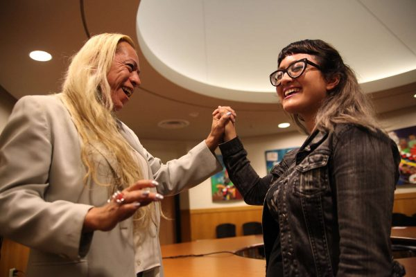 Bamby Salcedo entwines hands with Deziree Miller after Q&A with actvist in the ROMC Reading Room on Thursday, Oct. 30, 2014. Lorisa Salvatin/Xpress.