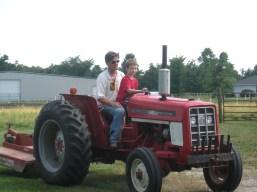 Carter driving Pops tractor