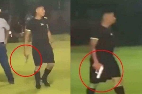 Moment Referee pulls out gun as fight breaks out during football match