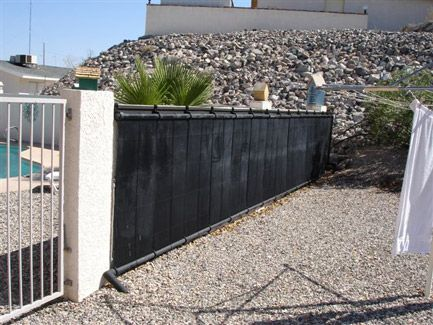 Heliocol solar pool heating panels are easily installed on fences or ground mounts.