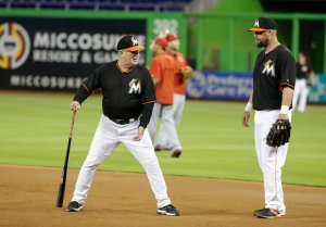 Perry Hill coaching baseball infield with Miami Marlins