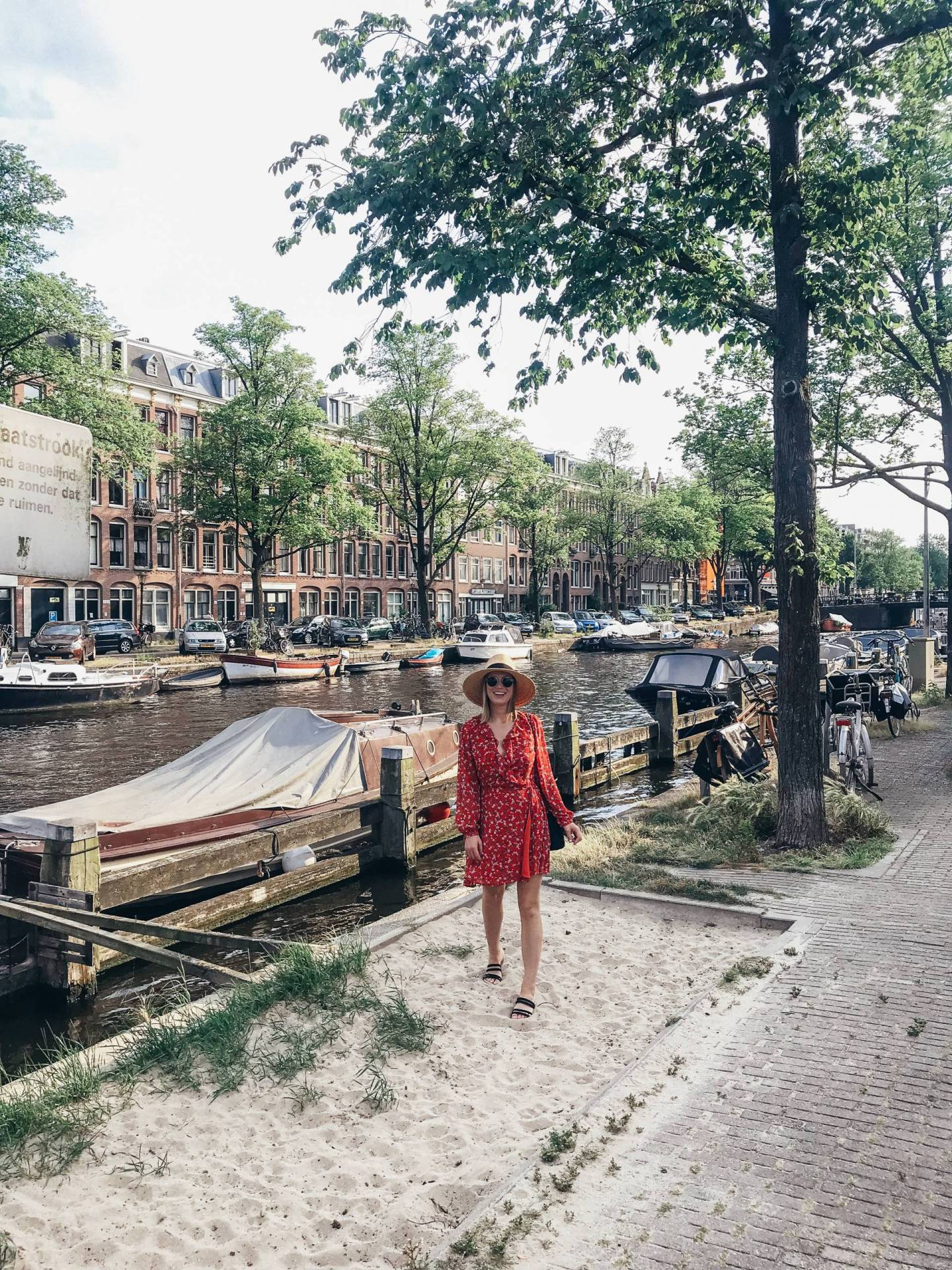 Wondering what to wear in Amsterdam? The weather in the Summer is pretty mild so this Glamorous wrap dress in vintage floral from ASOS was perfect with some sandals and a hat. Click through for a few more outfits I wore during our visit, plus what we did and where we ate!