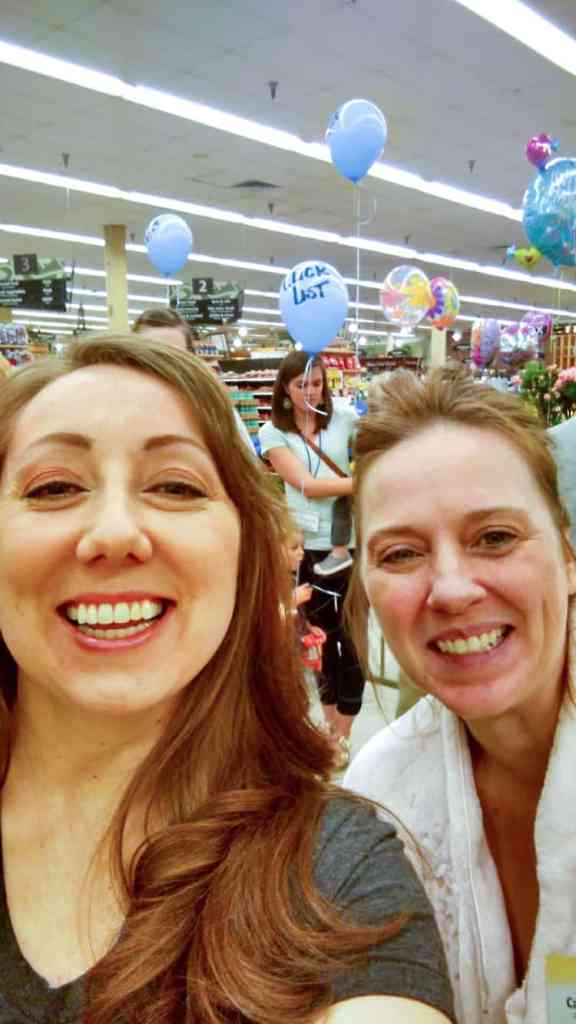 Two women pose for a selfie inside of Smith's Food and Drug for a Clicklist pajama party (with balloons in the background).