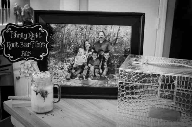 A black and white family picture sits next to a root beer float and a pretty box used as a time capsule.