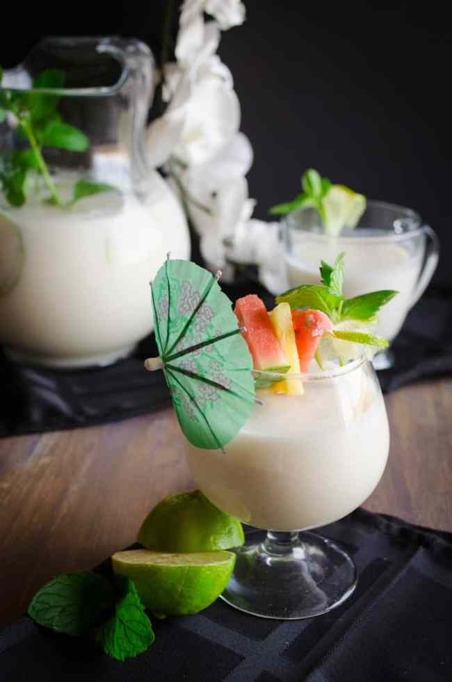 Glasses filled with Crowd Pleasing Coconut Lime Mocktail.