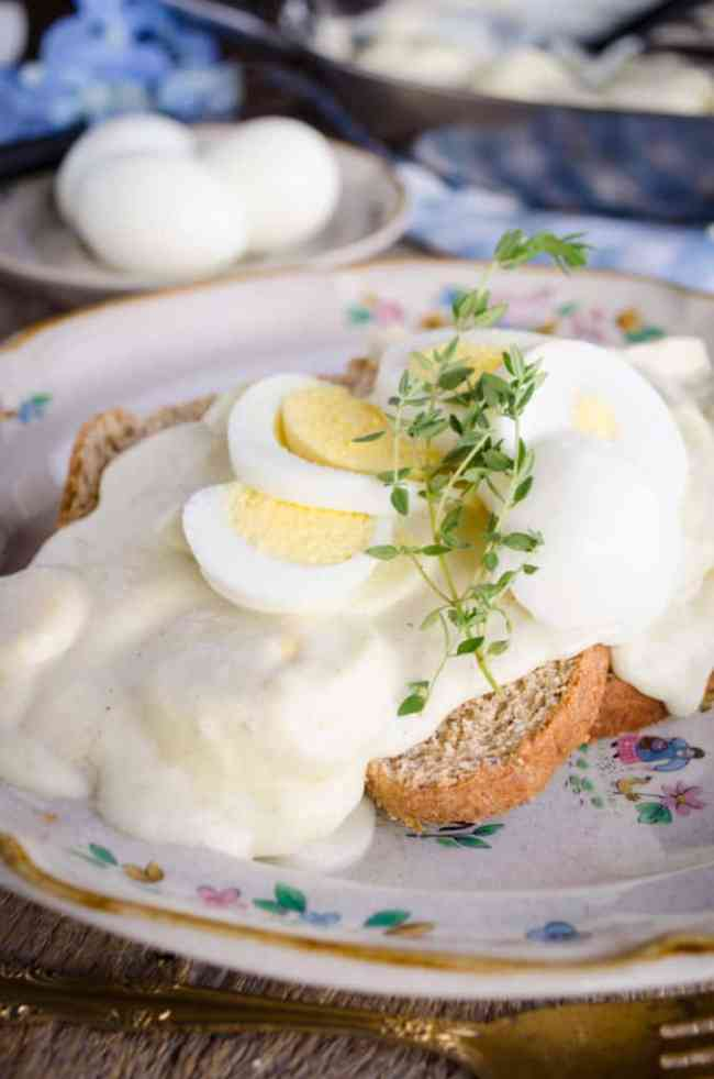 Classic Creamed Eggs on Toast garnished with fresh thyme.