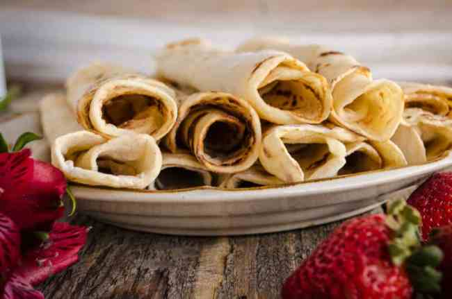 A close up of several rolled Norwegian Lefse. - The Goldilocks Kitchen