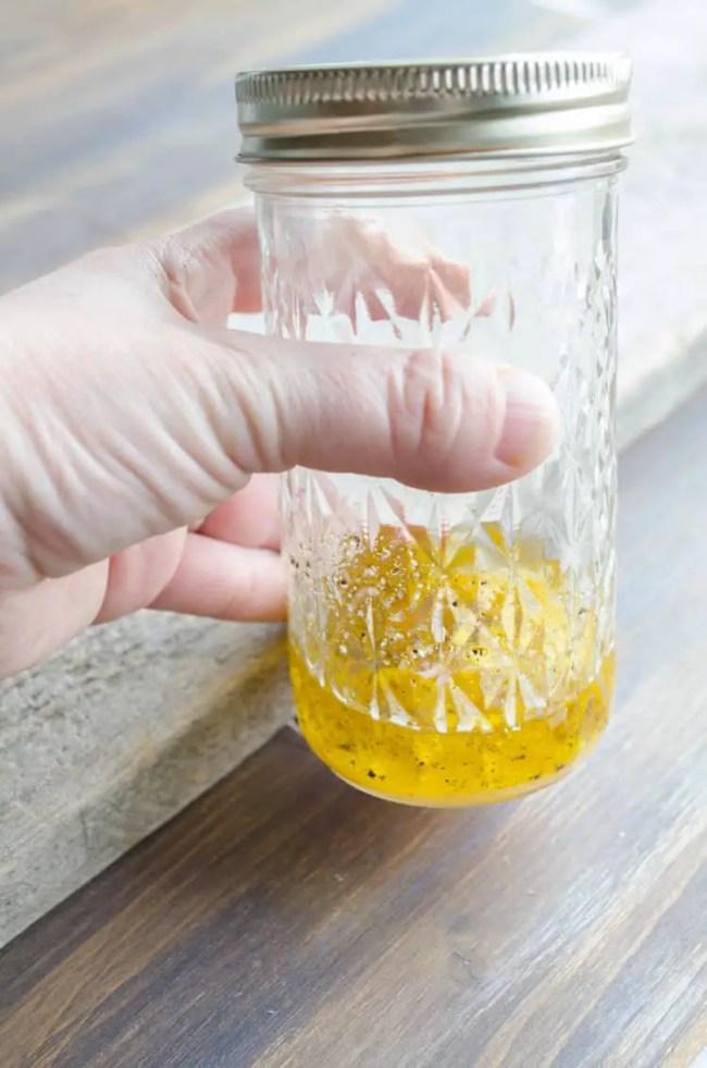 Feta Citrus Salad dressing in a decorative mason jar - The Goldilocks Kitchen