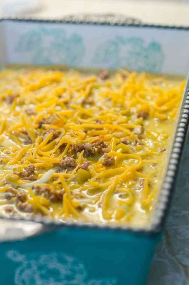 All the ingredients for Green Chile Breakfast Cubes are combined and poured into a casserole dish to bake in the oven.