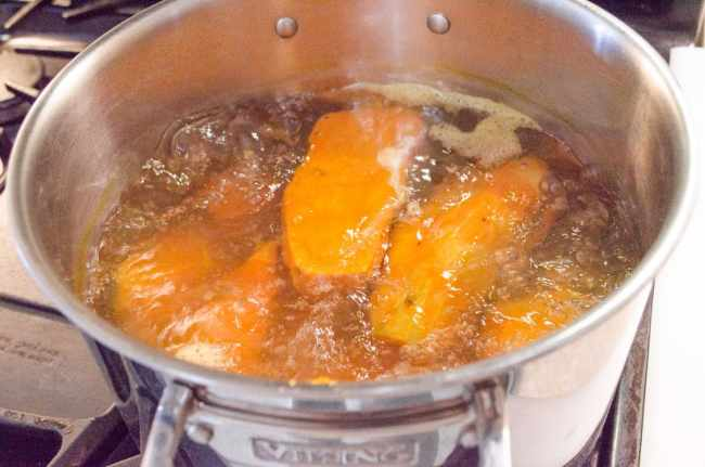 Sweet potatoes boil in a large stockpot to make Sweet Potato Tater Tots - The Goldilocks Kitchen