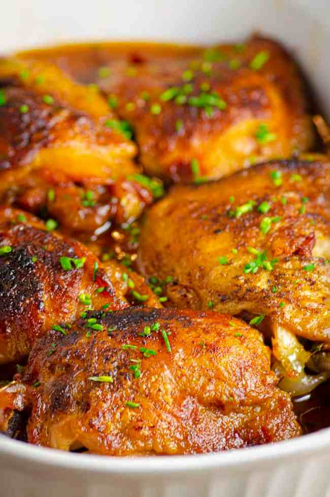 A close-up picture of deep golden brown Slow-Cooker Brown Sugar Apple Chicken ready to be served.