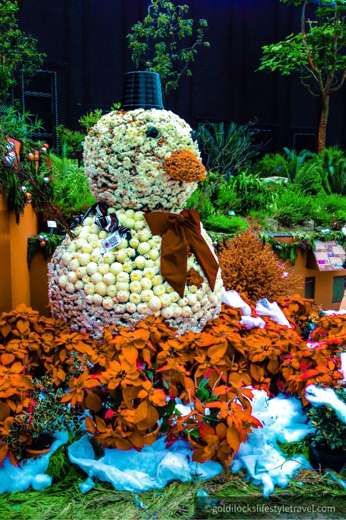 Snowman made by flowers in Garden By The Bay's Flower Dome