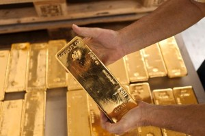 You can take a distribution, but still elect to keep your gold bullion as an investment.