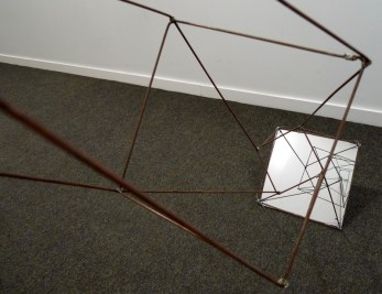 Geometric wire form with mirror base