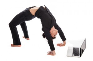 Flexible Workspaces Suited Woman In Yoga Pose working with Laptop.