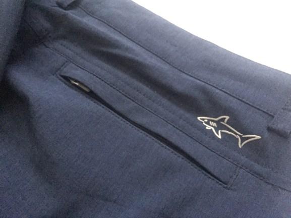 Reflective logo and zippered rear pocket