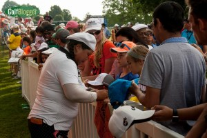 Christina Kim signs autographs following her round of 72.