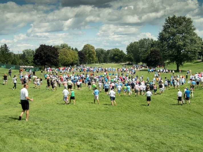 Fans heading down the first hole at the US Amateur afternoon finals.