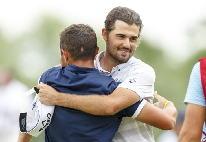 Curtis Luck, right, hugs Nick Carlson, left, after their match ended ont he 21st hole during semifinal round of match play at the 2016 U.S. Amateur at Oakland Hills Country Club in Bloomfield Hills, Mich. on Saturday, Aug. 20, 2016. (Copyright USGA/Chris Keane)