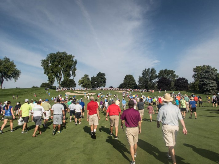 Huge crowds heading up the eighth fairway.
