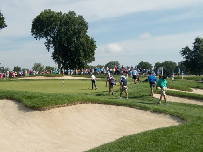 Carlson and Luck on the thirteenth green.