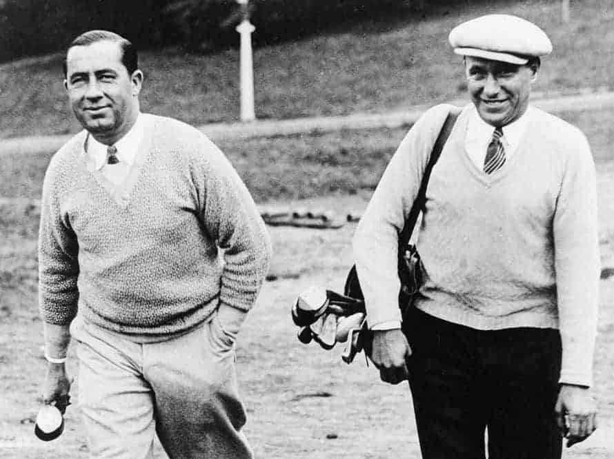 walter-hagen-left-and-his-caddy-jimmy-mcdonald-go-through-a-practice-round-at-the-1926-open-championship