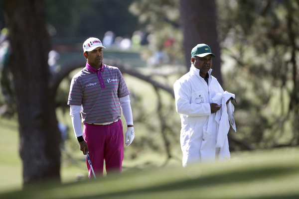 Anirban Lahiri of India and his caddie Rajiv Sharma look down No. 1 during Round 2 at Augusta National Golf Club on Friday April 8, 2016.