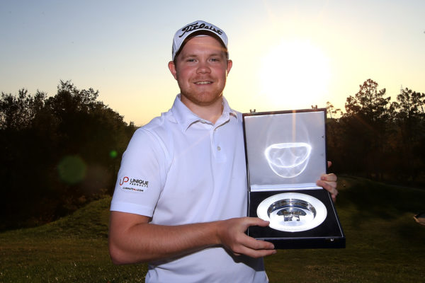 Tournament champion Nathan Kimsey of England poses following the final round of the European Tour qualifying school final stage at PGA Catalunya Resort