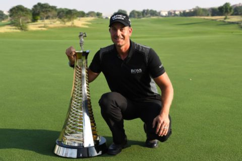 Henrik Stenson of Sweden poses with the Race to Dubai trophy during day four of the DP World Tour Championship at Jumeirah Golf Estates on November 20, 2016 in Dubai, United Arab Emirates.