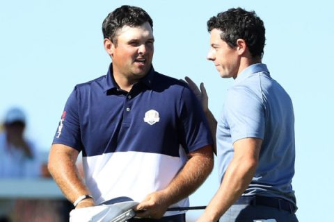 Patrick Reed of the United States shakes hands with Rory McIlroy of Europe after Reed won their match during singles matches of the 2016 Ryder Cup at Hazeltine National Golf Club on October 2, 2016 in Chaska, Minnesota. (Photo by David Cannon/Getty Images)