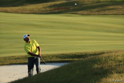 Rahil Gangjee extracts his ball from the sand