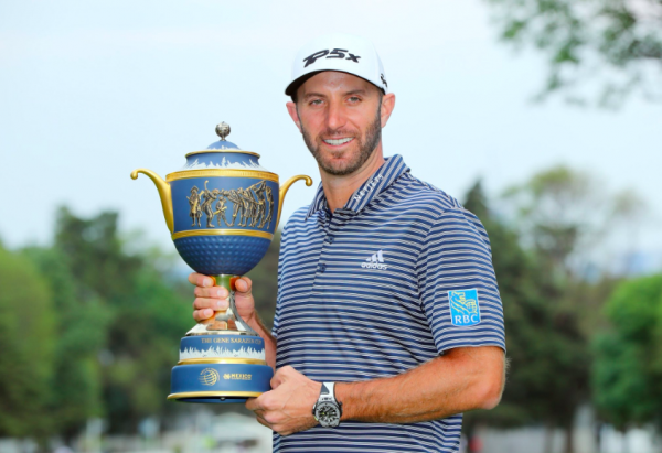 Dustin Johnson with his trophy at the WGC Mexico