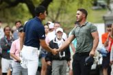 AUSTIN, TEXAS - MARCH 28: Brooks Koepka of the United States and Haotong Li of China shake hands on the 18th green after Li won 1up during the second round of the World Golf Championships-Dell Technologies Match Play at Austin Country Club on March 28, 2019 in Austin, Texas. (Photo by Ezra Shaw/Getty Images)