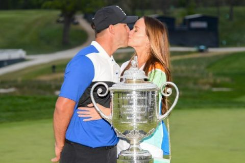 Jena Sims plants a kiss on Brooks Koepka after the PGA Championship - Getty Images - PGA TOUR