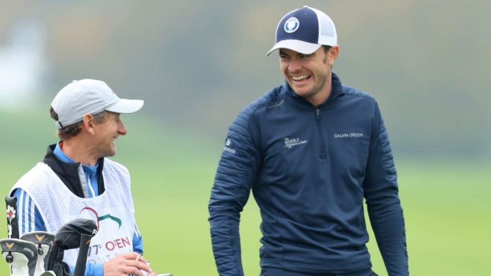 Laurie Canter smiles with his Caddy after finishing the opening round of Italian Open with a stunning sixty