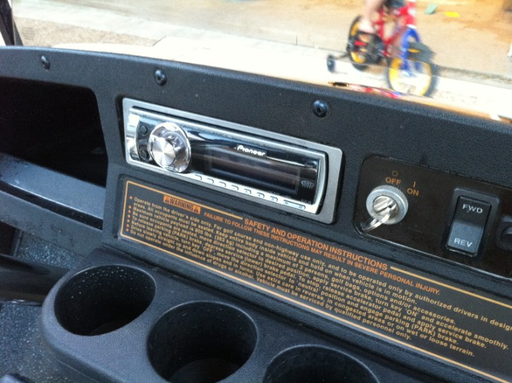 simple pioneer car stereo mounted in dash on golf cart
