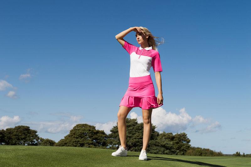 Golfspelare på golfbana i kläder från Daily Sports