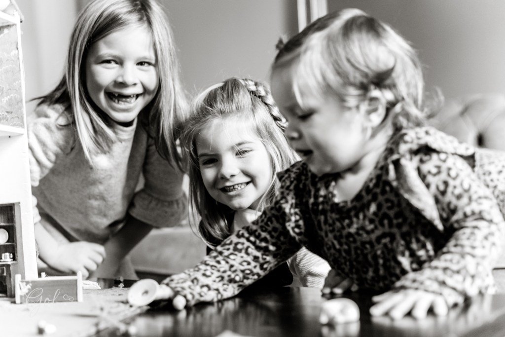 a family photo of the children at home playing