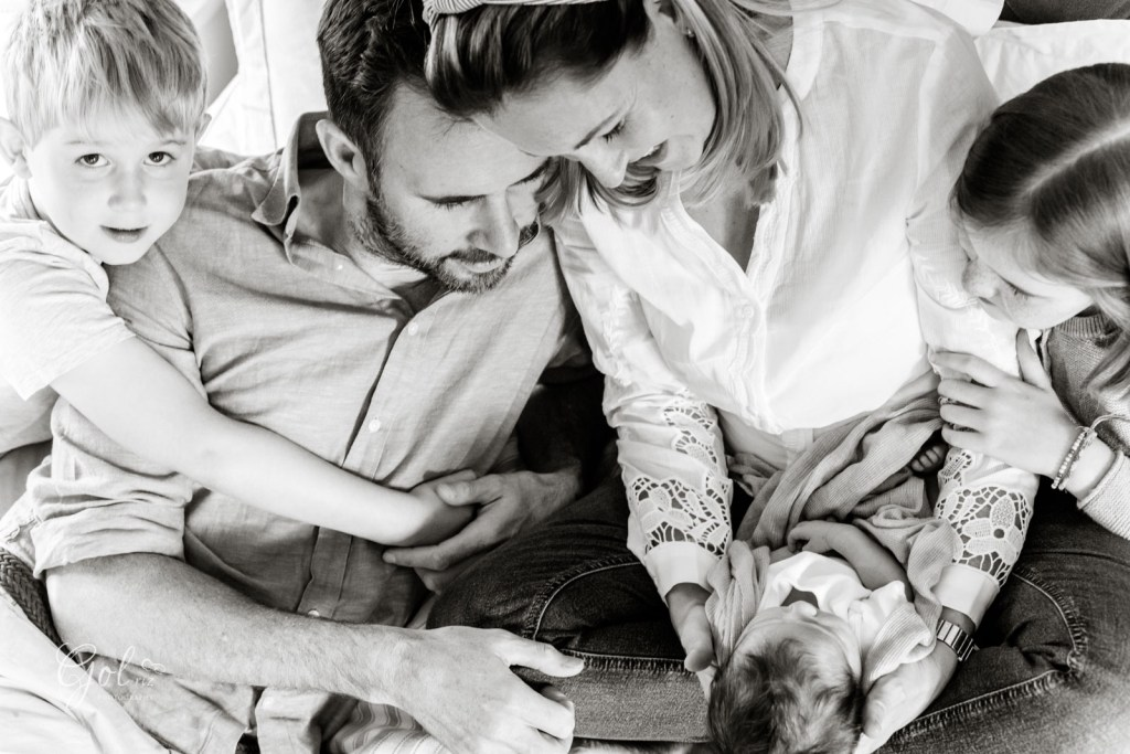 family of five with a newborn photoshoot at home