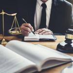 male-lawyer-or-judge-working-with-contract-papers.jpg