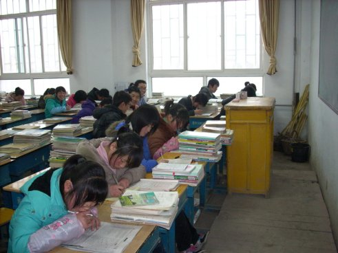 A normal day - students confined in the classroom - Students' potentials, creativity and future in rural China are severely limited. Teachers play a substantial role in their development.