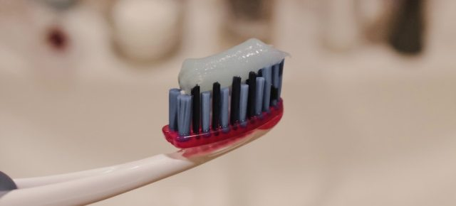 a toothbrush with paste on it