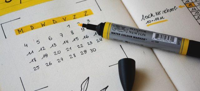 a calendar and a marker