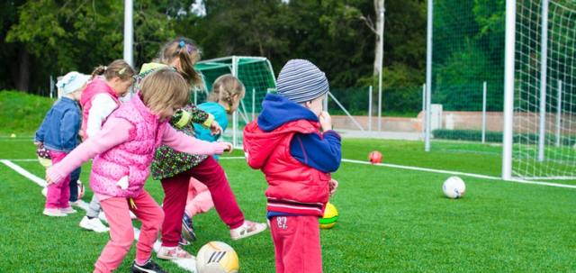 Kids on playground with balls